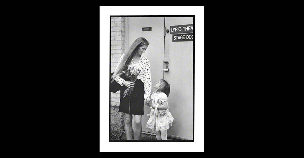 Ballerina with young girl at the theater's stage door