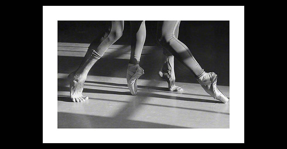 Close up of two ballet dancers feet in improvisational pose