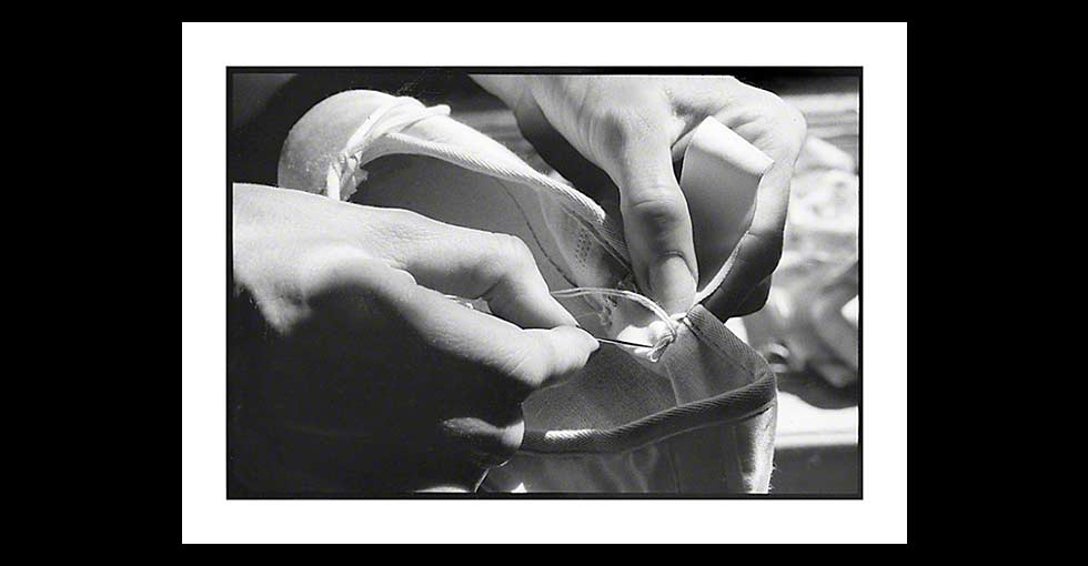 Ballet dancer sewing ribbon onto pointe shoe, photo by © Martha DiMeo, Available for Licensing