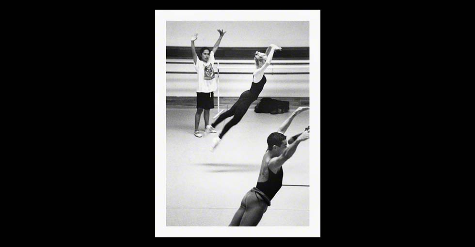 Ballet dancer jumping in the air in rehersal studio